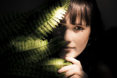 Woman Hiding Behind Fern Leaf Royalty Free Stock Image