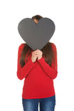 Woman hiding behind heart made from paper. Royalty Free Stock Image