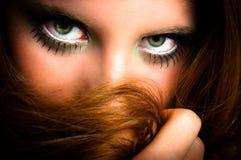 Woman hiding behind her hair Royalty Free Stock Photos
