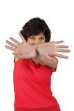 Woman hiding behind her hands. Brunette in a red top hiding behind her hands Stock Photography