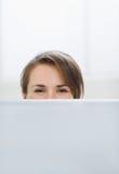 Woman hiding behind laptop Royalty Free Stock Photo