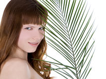 Woman hiding behind the palm leaf Stock Photography
