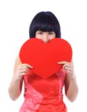 Woman hiding behind a red heart Royalty Free Stock Photos