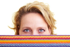 Woman hiding behind scarf Royalty Free Stock Photo