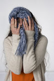 Woman hiding behind a scarf Royalty Free Stock Image