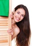Woman hiding behind screen Stock Photography