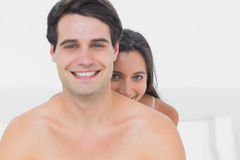 Woman hiding behind shirtless partner Royalty Free Stock Photo
