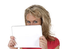 Woman hiding behind tablet pc Stock Images