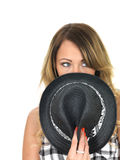 Woman Hiding Behind a Tilbury Hat Stock Photography