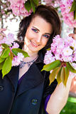 Woman hiding in the branch of tree blossoms Stock Photography