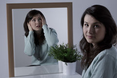 Woman hiding emotions. Young pretty smiling woman hiding her negative emotions Royalty Free Stock Photography