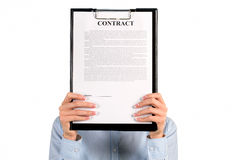 Woman hiding face behind clipboard. Royalty Free Stock Photos