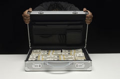 Woman Hiding Face Behind Suitcase Full Of Dollars Royalty Free Stock Image
