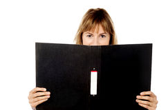 Woman hiding face with business file stock photography
