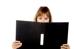 Woman hiding face with business file Royalty Free Stock Photo