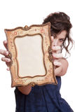 Woman hiding face with an picture frame Stock Photography