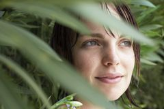 Woman Hiding In Foliage Royalty Free Stock Photo