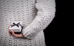 Woman hiding gift box. Behind her back Royalty Free Stock Photos