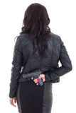 Woman hiding gun behind her back isolated on white. Background Royalty Free Stock Photography