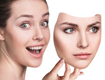 Woman hiding hapyiness under the serious mask. Young woman hiding hapyiness under the serious mask. Hypocritical, insincere, two-faced female Royalty Free Stock Image