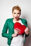 Woman hiding heart concept Stock Photo