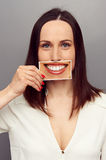 Woman hiding her emotions behind smile Stock Photo