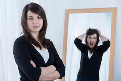 Woman hiding her emotions. Horizontal view of woman hiding her emotions Stock Photo