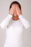 Woman hiding her eyes Stock Photo