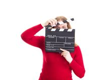 Woman hiding her face behind clapperboard Stock Photo