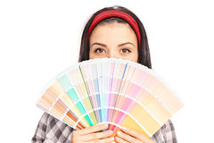 Woman hiding her face behind a color swatch Stock Photo