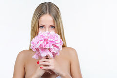 Woman hiding her face behind pink hydrangea Stock Images