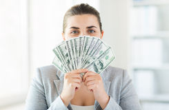 Woman hiding her face behind us dollar money fan Stock Photos
