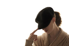 Woman hiding her face with a black hat Stock Image
