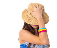 Woman hiding her face with the hat Stock Images