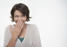 Woman Hiding Her Smile Stock Images
