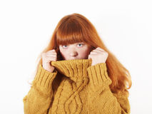 Woman hiding in her turtle neck Royalty Free Stock Images