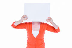 Woman hiding his head with blank paper Royalty Free Stock Photos