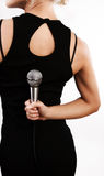 Woman hiding microphone Royalty Free Stock Images