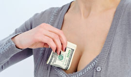 Woman hiding money in bra Royalty Free Stock Images