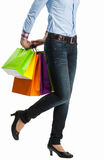 Woman hiding multicolored shopping paper bags Stock Photos