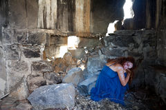 Woman hiding ruined building Royalty Free Stock Photo