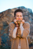Woman hiding in scarf in autumn evening outdoors Royalty Free Stock Photos