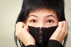 Woman hiding smile Stock Images