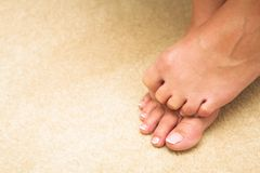 Woman hiding toes Royalty Free Stock Photography