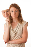 Woman hiding under the happy mask. Hypocritical, insincere, two-faced female Stock Photo