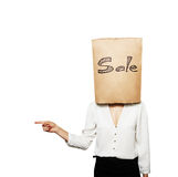 Woman hiding under shopping bag Royalty Free Stock Images