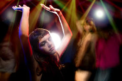 Woman High on Drugs or Drunk at a Club. Intoxicated female dancing at a nightclub and high on drugs or drunk Royalty Free Stock Photos