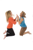Woman high five jump. Shot of two women high five jump Royalty Free Stock Images