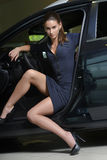 Woman with high heel shoes coming out of the car Royalty Free Stock Image