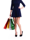 Woman in high heels with color shopping bags. Royalty Free Stock Image